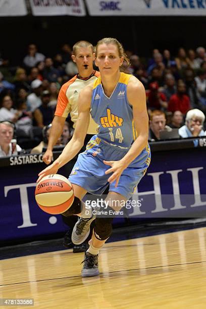 Allie Quigley of the Chicago Sky dribbles the ball against the San Antonio Stars on June 20 2015 at Freeman Coliseum in San Antonio Texas NOTE TO...