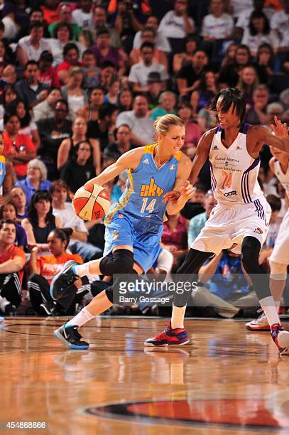 Allie Quigley of the Chicago Sky drives against DeWanna Bonner of the Phoenix Mercury in Game 1 of the 2014 WNBA Finals on September 7 2014 at US...
