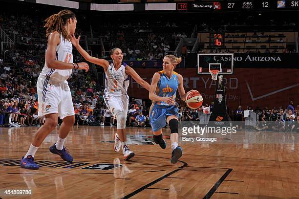 Allie Quigley of the Chicago Sky drives to the basket against Diana Taurasi and Brittney Griner of the Phoenix Mercury in Game 1 of the 2014 WNBA...