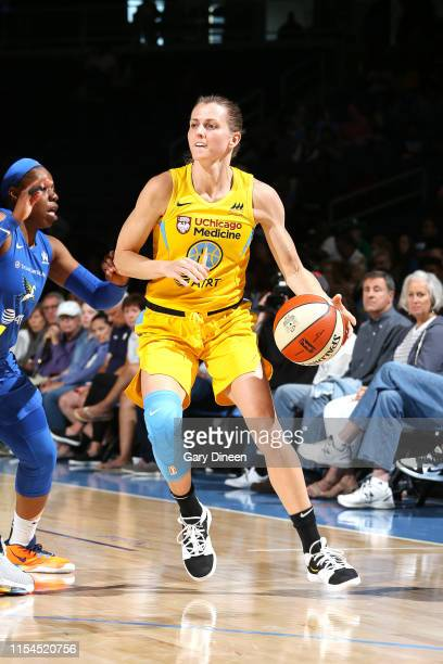 Allie Quigley of the Chicago Sky handles the ball during the game against the Dallas Wings on July 7 2019 at the Wintrust Arena in Chicago Illinois...
