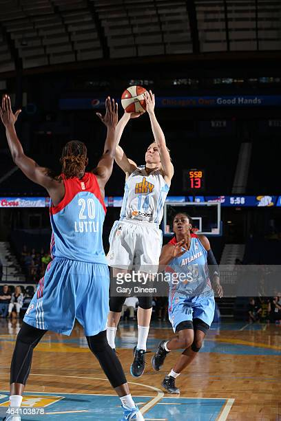 Allie Quigley of the Chicago Sky shoots the ball against Sancho Lyttle of the Atlanta Dream as Tiffany Hayes of the Dream watches in Game Two of the...