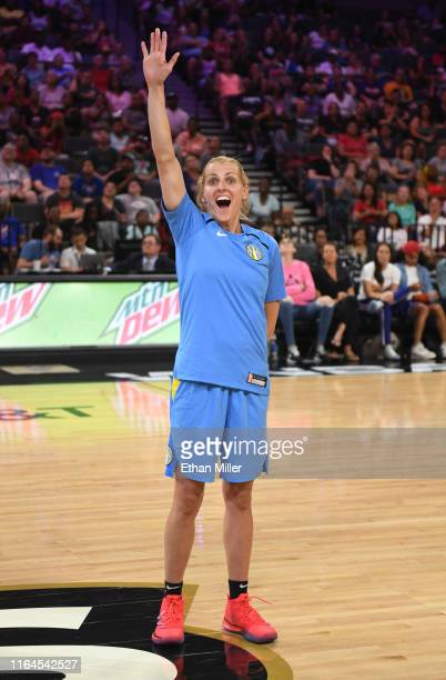 Allie Quigley of the Chicago Sky waves as she is introduced before competing during the 3Point Contest of the WNBA AllStar Friday Night at the...