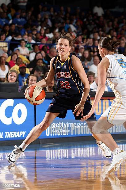 Allie Quigley of the Indiana Fever moves the ball up court against Erin Thorn of the Chicago Sky during the WNBA game at the AllState Arena on May 22...
