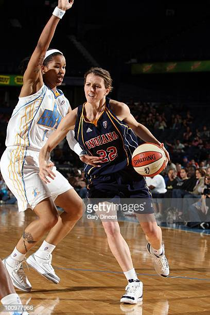 Allie Quigley of the Indiana Fever moves the ball up court against Tamera Young of the Chicago Sky during the WNBA game at the AllState Arena on May...