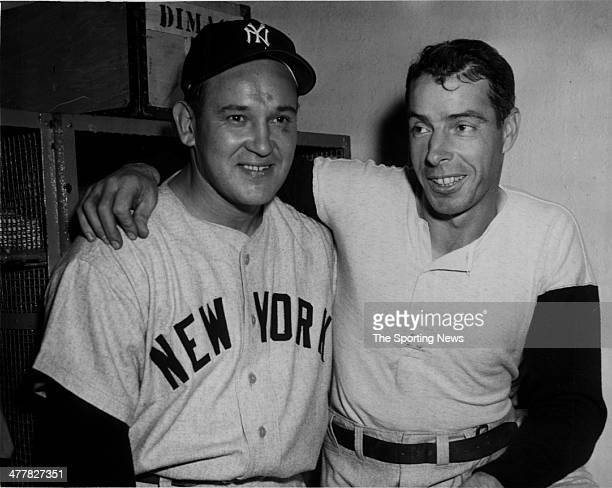 Allie Reynolds and Joe DiMaggio of the New York Yankees celebrate in the locker room after Game Four of the 1951 World Series against the New York...