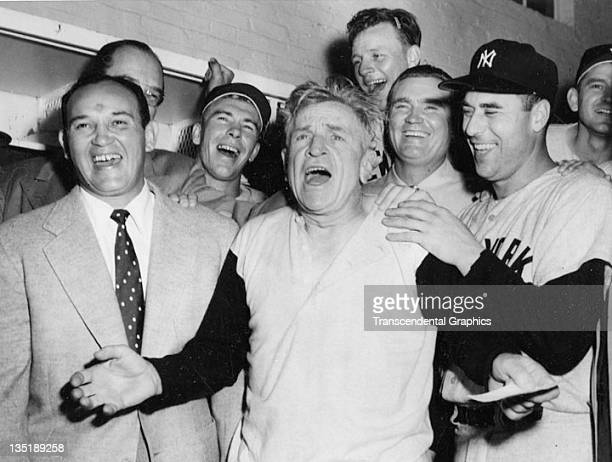 WASHINGTON DC SEPTEMBER 1954 Allie Reynolds Casey Stengel and Johnny Sain of the New York Yankees celebrate the clinching of the pennant in their...