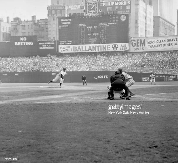 Allie Reynolds of the Yankees at the start of Game 1 of the World Series pitching to the National League Rookie of the Year Dodgers second baseman...