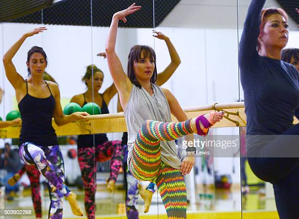 Allie Schneider exercises during a Barre class at the Colorado Athletic Club Downtown on January 6 2016 in Denver Colorado Fitness classes like the...