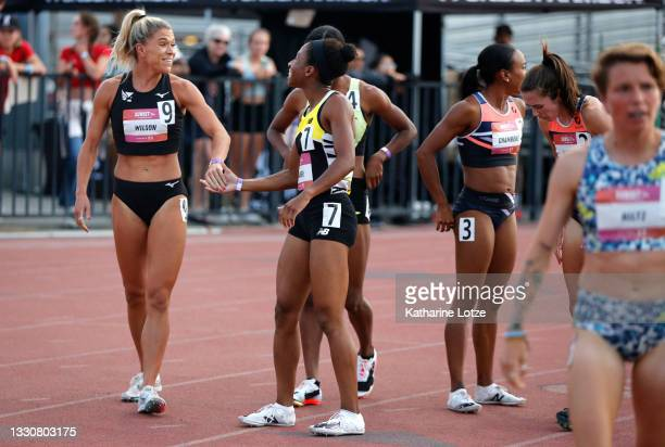Allie Wilson and Olivia Baker smile after finishing the women's 800 meter run during the Under Armour Sunset Tour on July 25, 2021 in Azusa,...