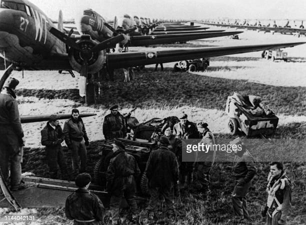 Allied aircrews work around C47 transport planes at an unidentified English base in this photo taken shortly before the DDay landings in Normandy...