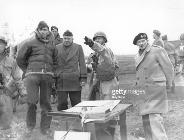 Allied Chiefs Air Marshal Arthur Tedder General Dwight D Eisenhower and Field Marshall Bernard L Montgomery watch tank manoeuvres in preparation for...