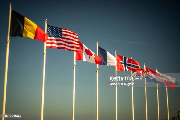 allied flags at saint-aubin-sur-mer, sword beach site - national flag stock pictures, royalty-free photos & images