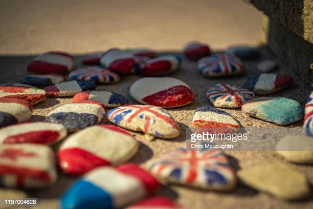 allied flags at saint-aubin-sur-mer, sword beach site - allied forces stock pictures, royalty-free photos & images