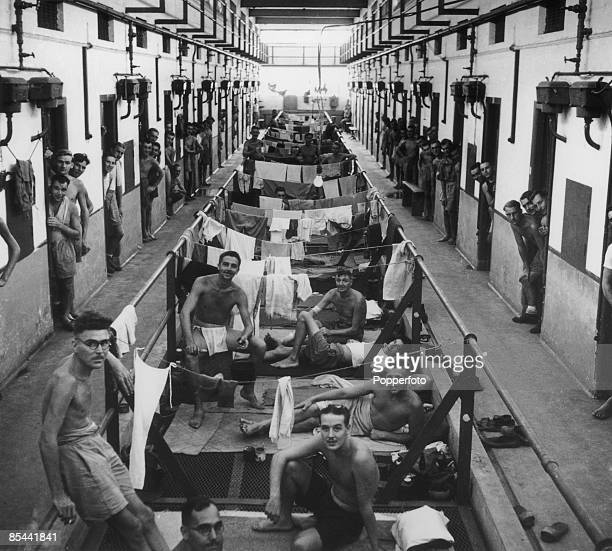 Allied inmates of the Changi prisonerofwar camp on Singapore during the Japanese occupation of World War II 1945