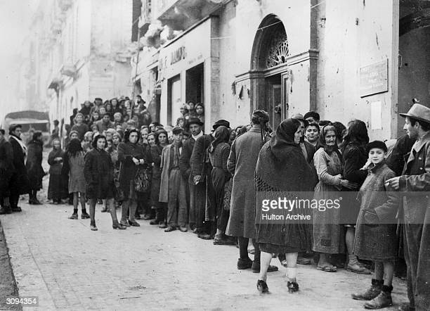 Allied relief organisations establish food centres, in this case in an Italian town, to feed a population left destitute by the Nazis.