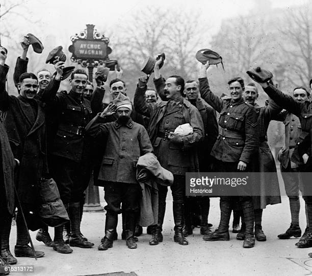 Allied soldiers in Paris wave their caps in recognition of the armistice.