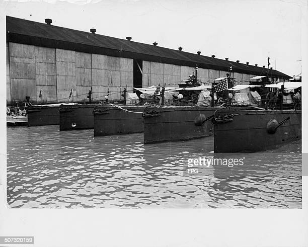 Allied submarines docked in Manila during World War Two Philippines circa 1943