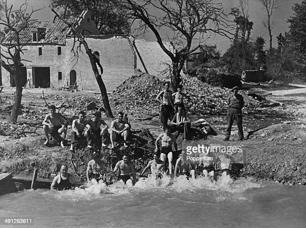 Allied troops bathing in a pool in a rest break during the Battle of the Falaise Pocket part of the Battle of Normandy France August 1944 The pool is...