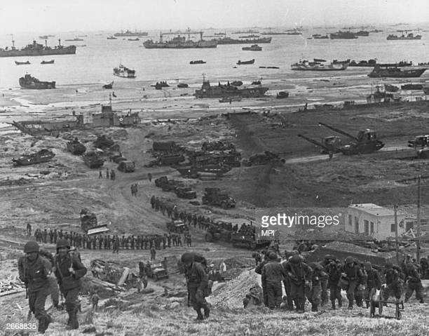 Allied troops build roadways at a beach in northern France so that supplies and troops can get through to reinforce units already in combat