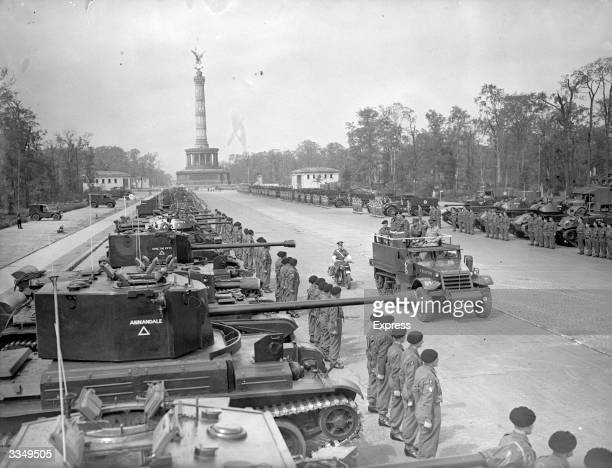 Allied troops stand to attention in front of their tanks after entering Berlin Field Marshal Montgomery addresses them from a truck