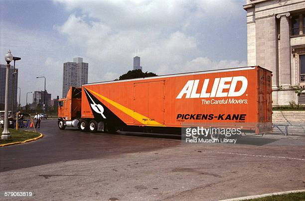 Allied Van lines semitrailer truck leaving Museum Preparing Sue TRex / Tyrannosaurus Rex skull for being sent to California for CT scan process