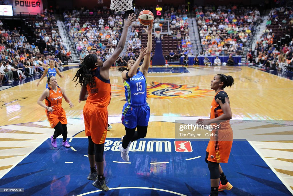 Allisha Gray #15 of the Dallas Wings drives to the basket defended by Jonquel Jones #35 of the Connecticut Sun during the Connecticut Sun Vs Dallas Wings, WNBA regular season game at Mohegan Sun Arena on August 12th, 2017 in Uncasville, Connecticut.