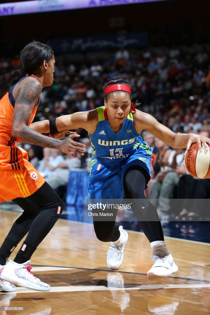 Allisha Gray #15 of the Dallas Wings handles the ball against the Connecticut Sun on August 12, 2017 at Mohegan Sun Arena in Uncasville, CT.