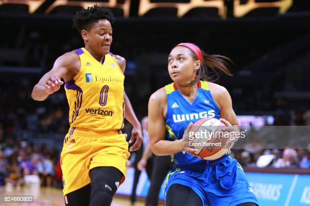 Allisha Gray of the Dallas Wings handles the balll against Alana Beard of the Los Angeles Sparks during a WNBA basketball game at Staples Center on...