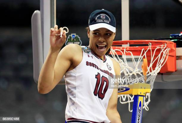 Allisha Gray of the South Carolina Gamecocks cuts down the net after her teams championship win over the Mississippi State Lady Bulldogs after the...