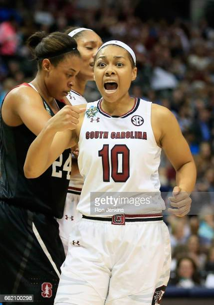 Allisha Gray of the South Carolina Gamecocks reacts after a foul was called in the first half against the Stanford Cardinal during the semifinal...