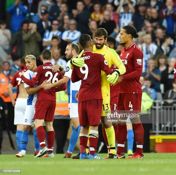 THE SUN OUT THE SUN ON SUNDAY OUT Allison Becker of Liverpool at the end of the Premier League match between Liverpool FC and Brighton Hove Albion at...