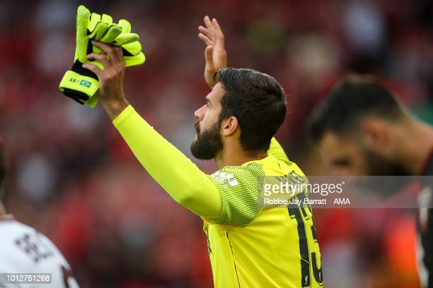 Allison Becker of Liverpool prays as he was on to the pitch during the preseason friendly between Liverpool and Torino at Anfield on August 7 2018 in...