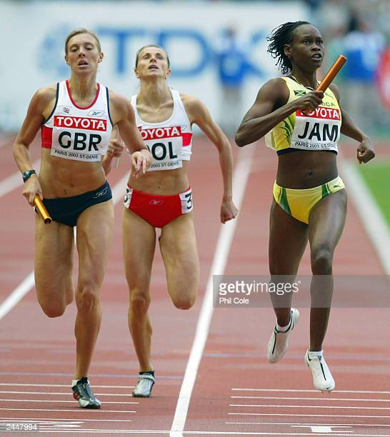 Allison Beckford of Jamaica in action next to Lee McConnell of Great Britain and Grazyna Prokopek of Poland during the first round of the women's...