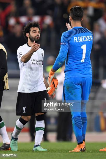 Allison Beker of AS Roma congratulates Mohamed Salah of Liverpool FC at the end of the UEFA Champions League semi final return match between AS Roma...