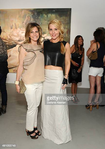 Allison Berg and artist Stephanie Hirsch attend the grand opening of De Re Gallery on May 15 2014 in West Hollywood CA
