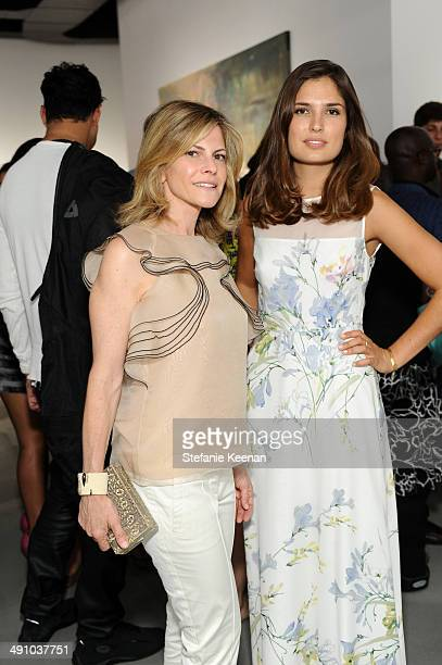 Allison Berg and Marine Tanguy attend the grand opening of De Re Gallery on May 15 2014 in West Hollywood CA