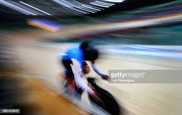 Allison Beveridge of Canada is given a start by a coach during the Women's Omnium Flying Lap 56 race on Day 11 of the Rio 2016 Olympic Games at the...