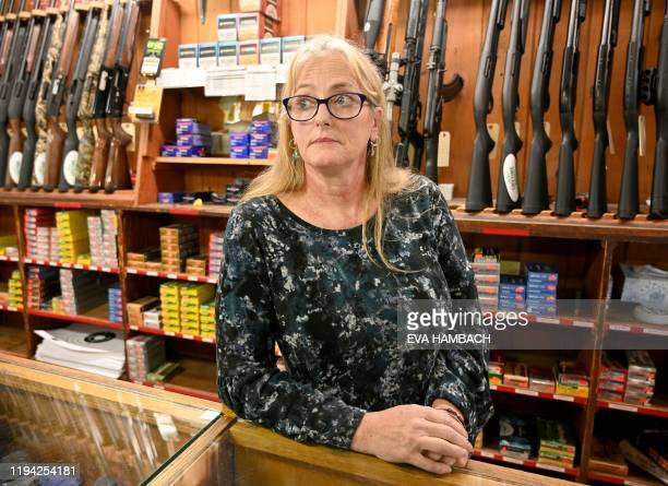 Allison Clark one of the owners of Clark Brothers gun store speaks to AFP in support of Culpeper County Sheriff Scott Jenkins inside her store in...