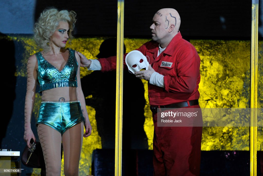 Allison Cook as Prostitute and Johan Reuter as Siskov in the Royal Opera's production of Leos Janacek's From the House of the Dead directed by Krzysztof Warlikowski and conducted by Mark Wigglesworth at the Royal Opera House on March 6, 2018 in London, England.