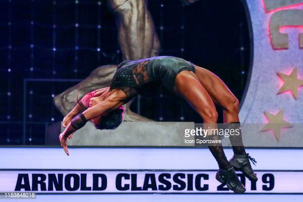 Allison Ethier competes in Fitness International as part of the Arnold Sports Festival on March 1 at the Greater Columbus Convention Center in...