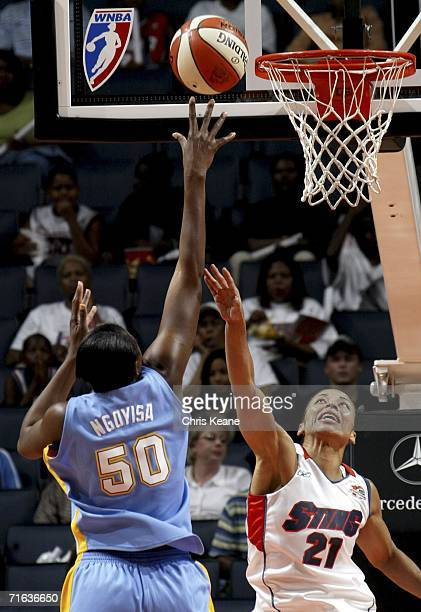 Allison Feaster of the Charlotte Sting tries to block the shot of Bernadette Ngoyisa of the Chicago Sky on August 12 2006 at the Charlotte Bobcats...