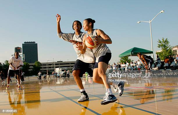 Allison Feaster of the Indiana Fever drives on Tammy SuttonBrown of the Fever as they practice outside near Conseco Fieldhouse July 10 2008 in...