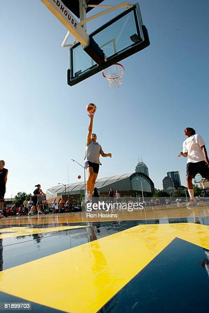 Allison Feaster of the Indiana Fever shoots a layup during the Fevers practice near Conseco Fieldhouse July 10 2008 in Indianapolis Indiana They are...