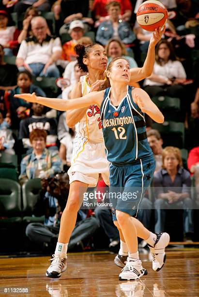 Allison Feaster of the Indiana Fever takes the ball away from Laurie Koehn of the Washington Mystics at Conseco Fieldhouse on May 17 2008 in...