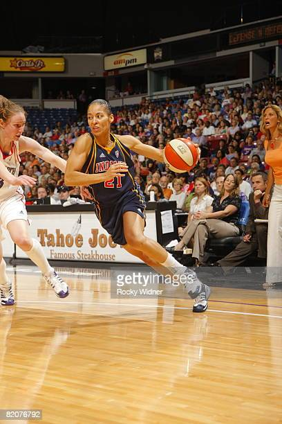 Allison Feaster of the Indiana Fever takes the ball to the basket against Kim Smith of the Sacramento Monarchs on July 26 2008 at ARCO Arena in...