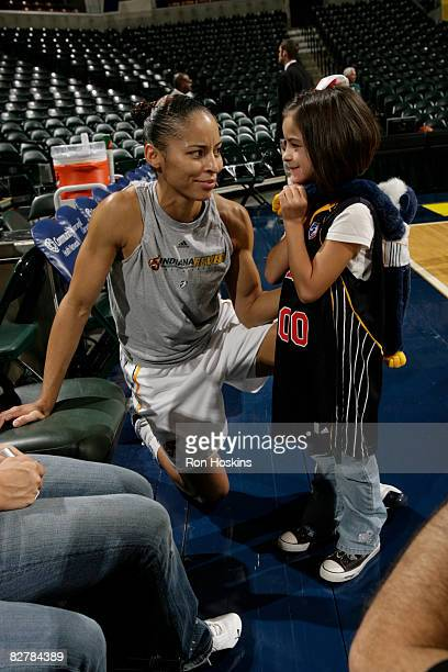 Allison Feaster of the Indiana Fever talks with Brooklyn Willis of Fishers Indiana at Conseco Fieldhouse on September 11 2008 in Indianapolis Indiana...
