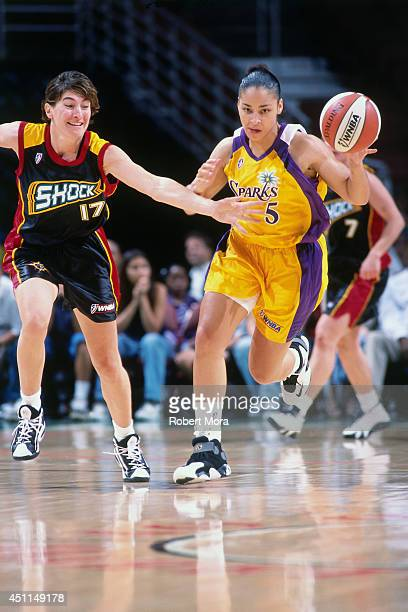 Allison Feaster of the Los Angeles Sparks drives against Elena Tornikidou of the Detroit Shock at Staples Center on May 29 1999 in Los Angeles CA...