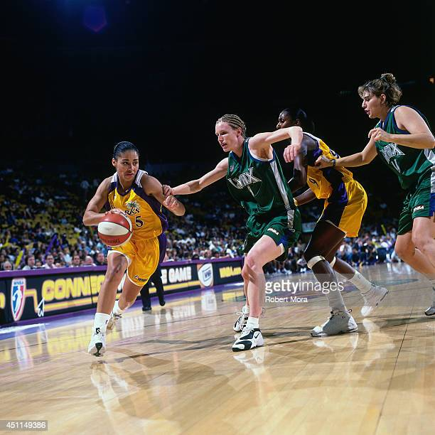 Allison Feaster of the Los Angeles Sparks drives against the Minnesota Lynx at Staples Center on June 24 1999 in Los Angeles CA NOTE TO USER User...