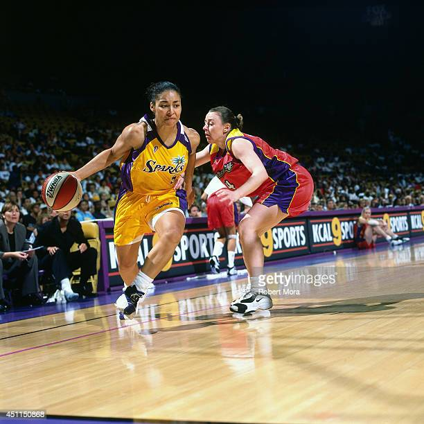 Allison Feaster of the Los Angeles Sparks drives against the Phoenix Mercury at Staples Center on July 11 1999 in Los Angeles CA NOTE TO USER User...