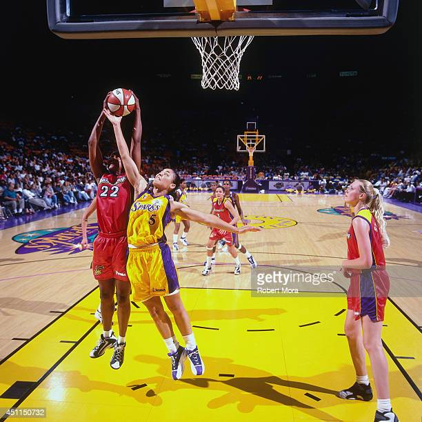 Allison Feaster of the Los Angeles Sparks grabs a rebound against the Phoenix Mercury at Staples Center on July 21 1999 in Los Angeles CA NOTE TO...
